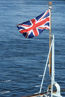 Union Jack flag waving on a yacht